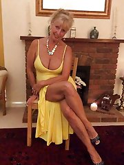 Posh old cougar posing outdoors