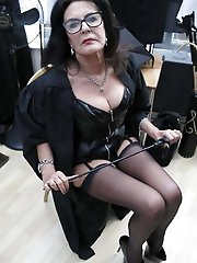 Unbelievable mature businesswomen spreading their lips on picture