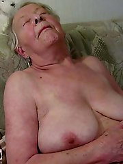 Lovely mature mama spreading her legs
