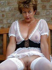 Gallant older businesswoman getting naked