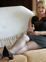 Mature lass spreading her legs