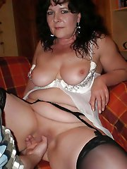 Busty mature female getting nude
