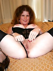Sexy mature mom getting naked