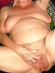 Attractive mature whore getting undressed