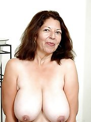 Mature prostitute getting undressed on picture