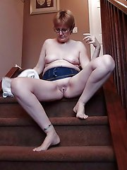 Sexy mature milf playing with her breasts