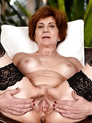 Fiery mature housewife posing undressed outdoors