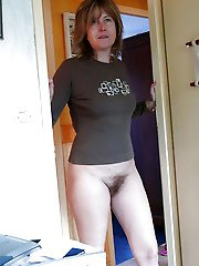 Seductive older cougar spreading her hips