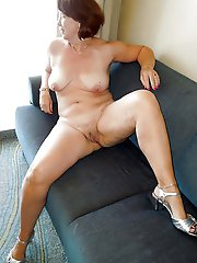 Lewd older businesswomen get nude