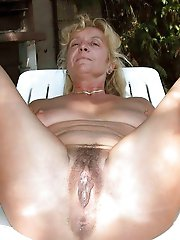 Posh mature mademoiselle playing with her jugs