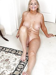 Gallant mature prostitute playing with her twat