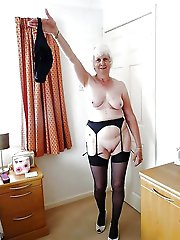Older cougar taking off her underwear