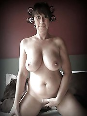 Delicious granny posing undressed