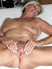 Mature mistress is masturbating herself